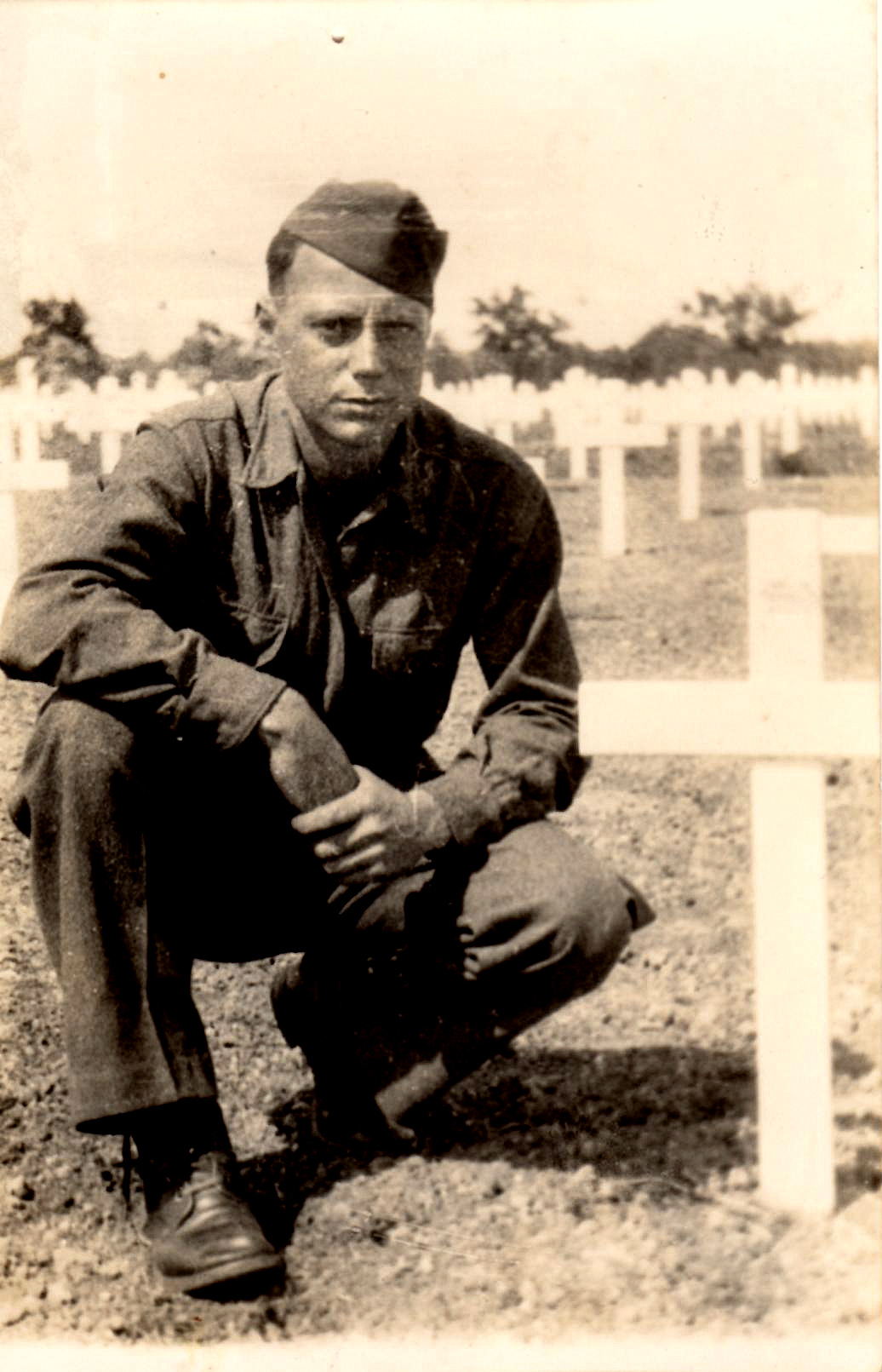 My Grandfather at the grave of his 19-year-old brother, Tommy. France, 1944.