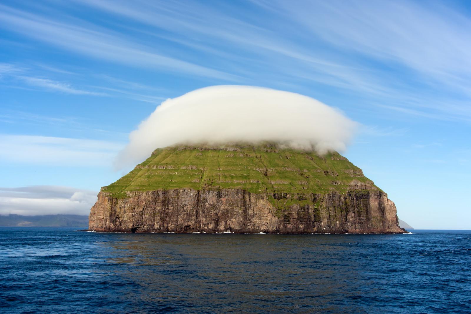 The cloud covered island of Litla Dimun, the largest uninhabited Faroe Island