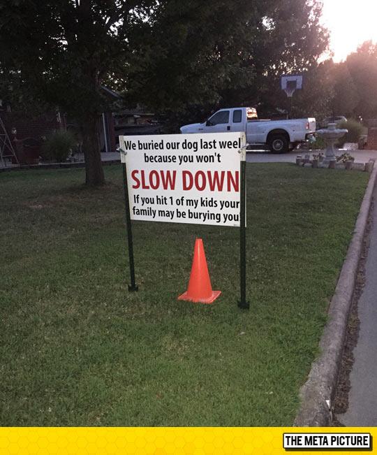 funny-sign-slow-down-orange-cone