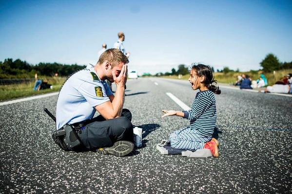 Danish police officer playing peek a boo
