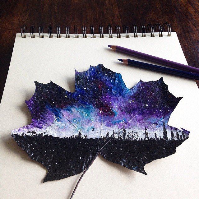 Drawing with pencils on fallen leaves