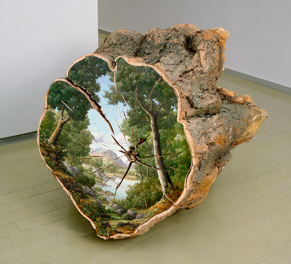 Landscape painted on the surface of a cut log