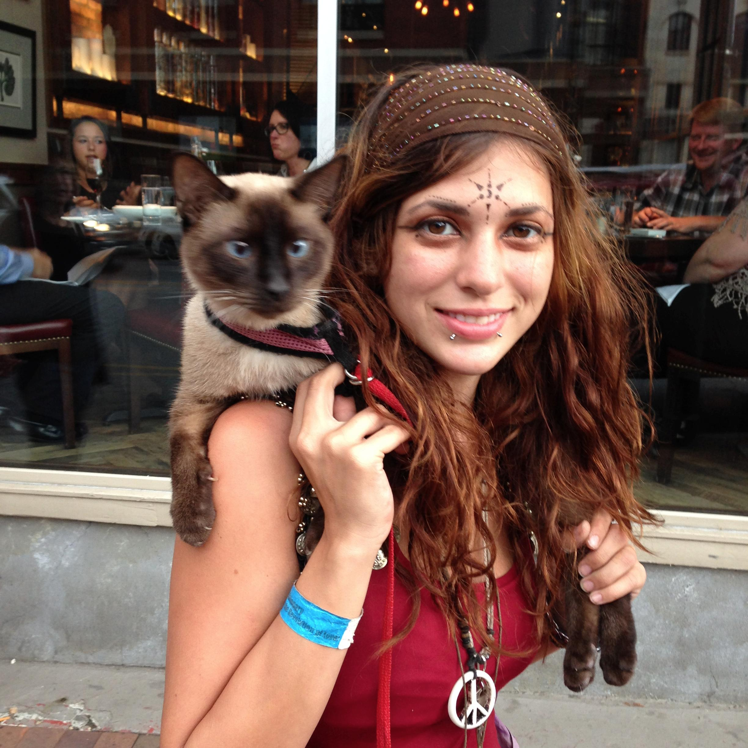 Random girl with a cat on her shoulder