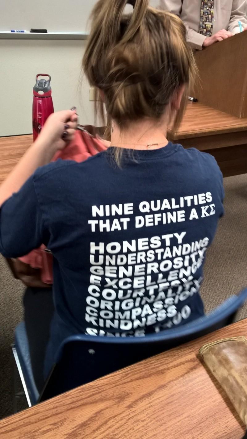 girls shirt says HugeCocks down the side
