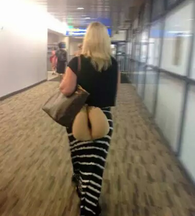 25 This woman that should probably carry her neck pillow differently next time.