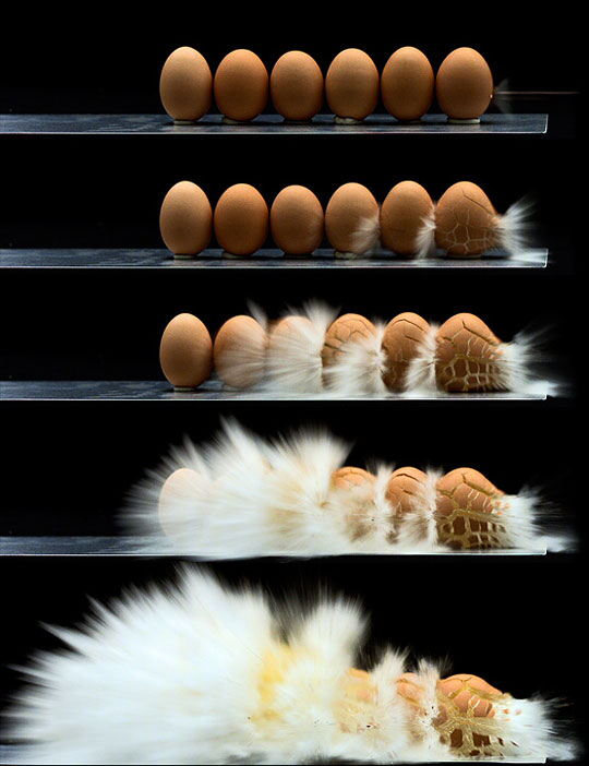 A sniper rifle shooting a line of eggs