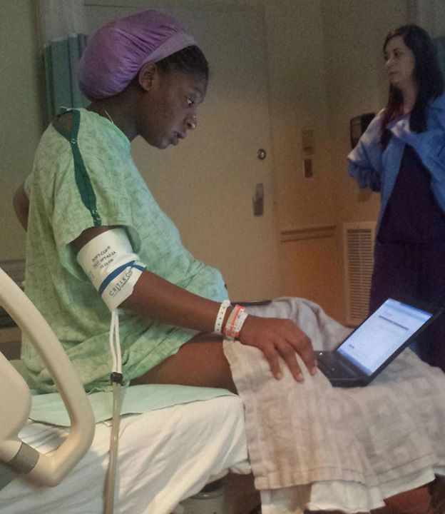 Woman finishing exam while in labor