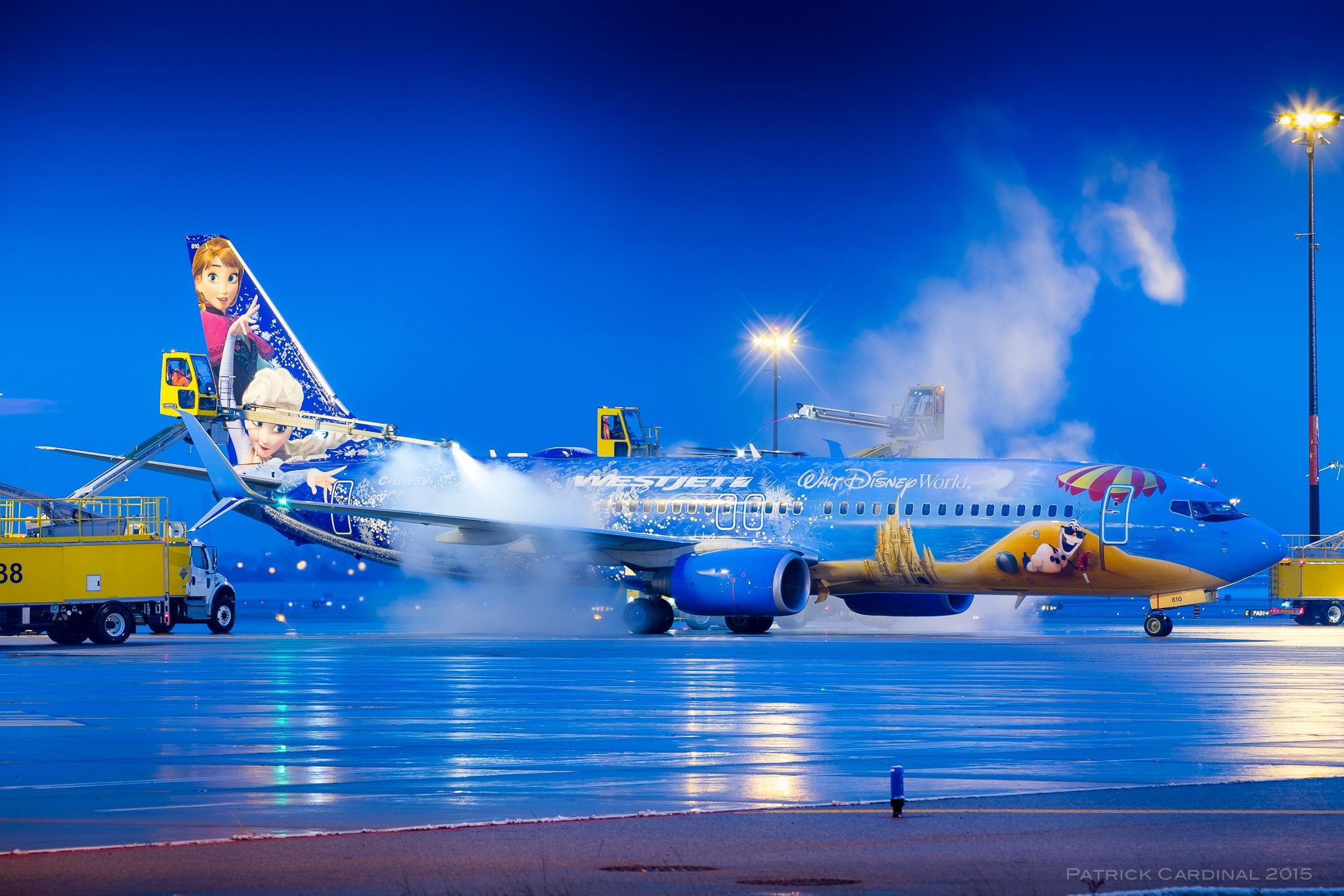 Airport ground crews de-icing a Frozen plane