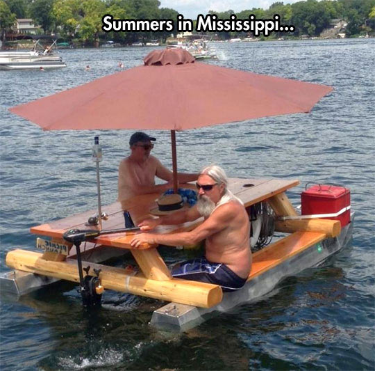 cool-motor-boat-table-umbrella-river