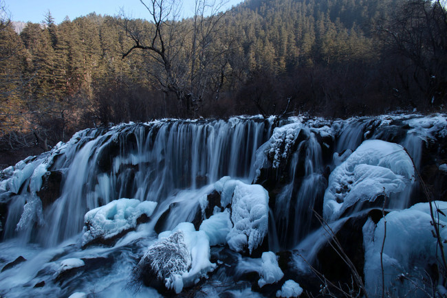 JIUZHAIGOU COUNTY, CHINA - JANUARY 18: (CHINA OUT) The frozen Shuzheng Waterfall is seen at the Jiuzhaigou Scenic Spot on January 18, 2011 in Jiuzhaigou County of Aba Tibetan and Qiang Autonomous Prefecture, Sichuan Province, China. Known as a fairyland on the earth, Jiuzhaigou is famous for its dozens of waterfalls and turquoise-colored lakes. (Photo by China Photos/Getty Images)