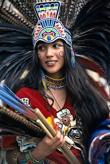 Woman in traditional aztec outfit.
