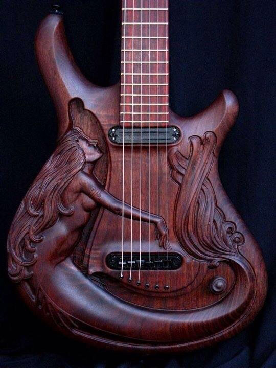 Magnificent Carved Guitar