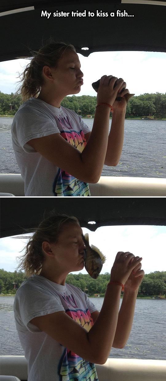 cool-girl-kissing-fish-boat-lake