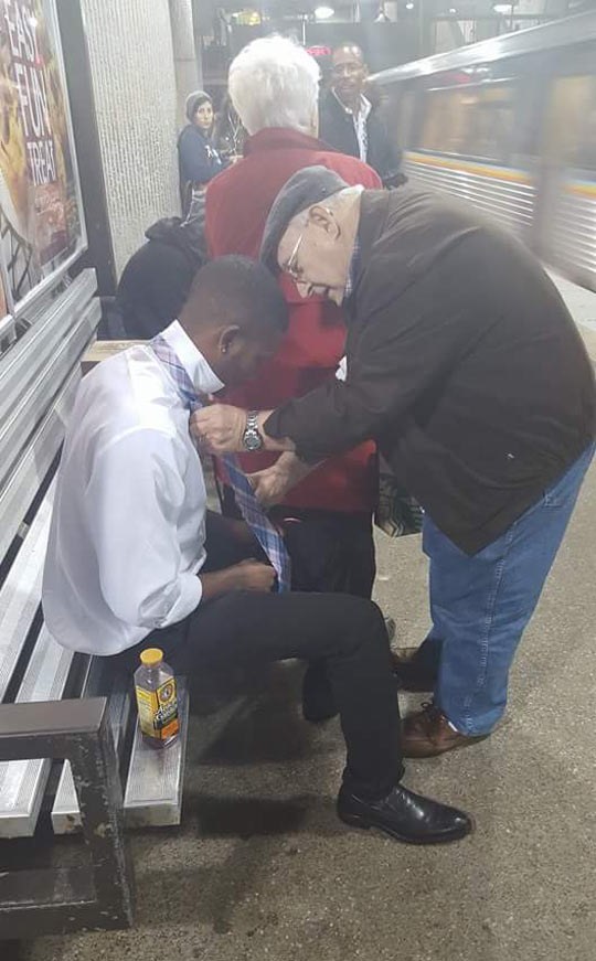 Older Man Helps Young Man Tie A Tie