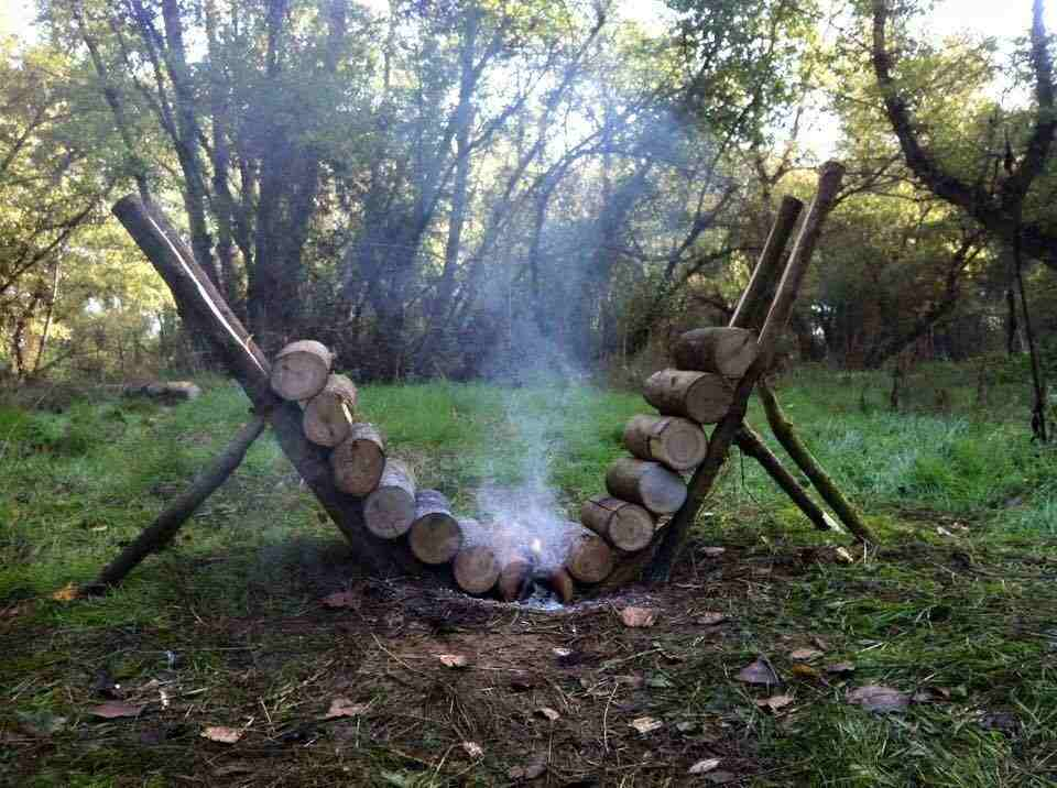 Self-feeding fire pit.