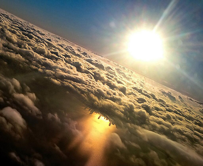 The Chicago skyline shadow reflects off Lake Michigan, under the clouds