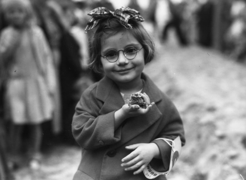 Young girl with her pet toad, 193