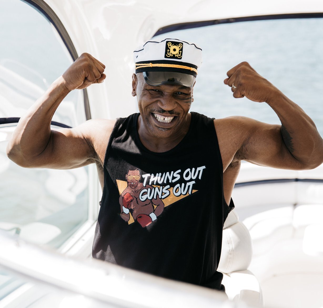 Mike Tyson On A Yacht Wearing A Thuns Out Guns Out Shirt