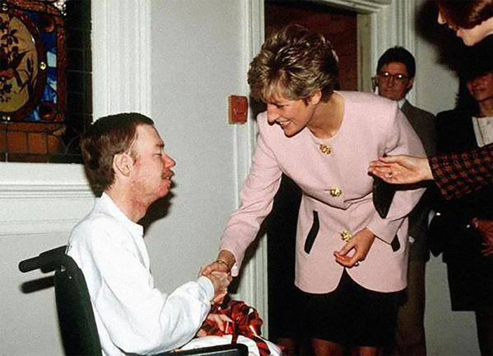 Princess Diana shakes hands with an AIDS patient without gloves, a profound gesture at the time, 1991
