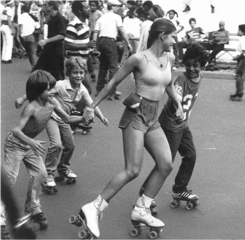 Girl skating with kids circa 1970
