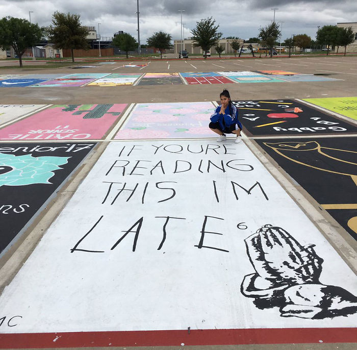 High School Seniors paint their own parking spaces.