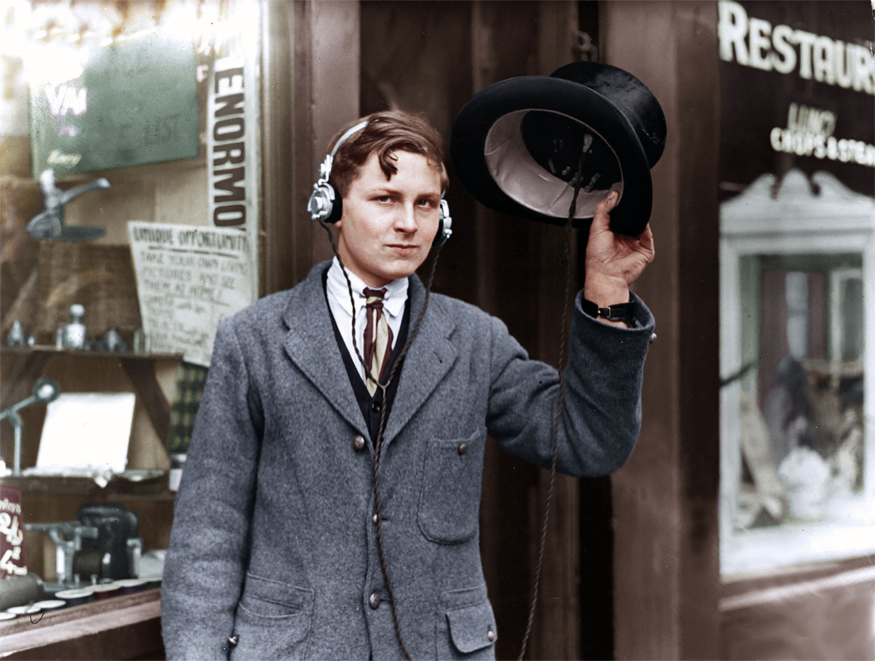 Man wearing headphones in 1922.