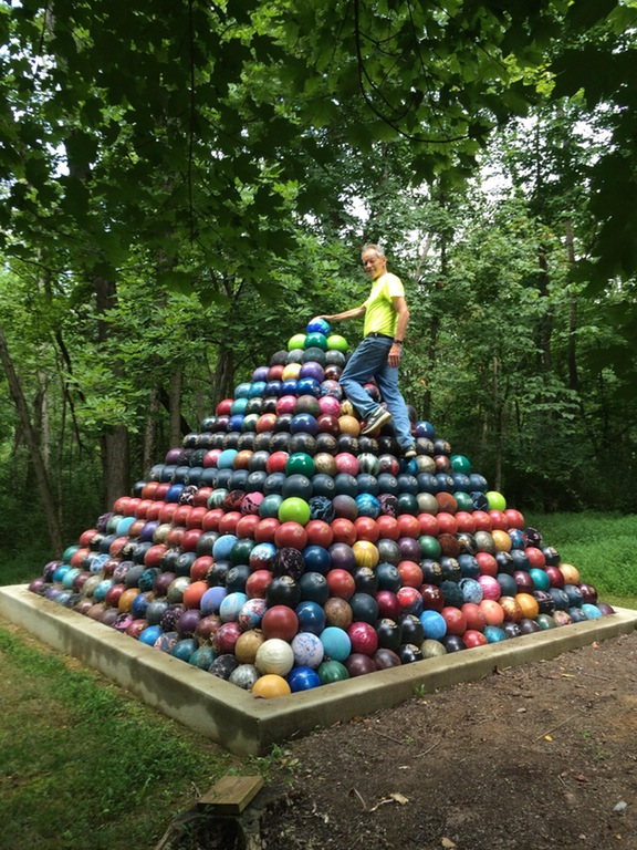 built a giant Bowling Ball Pyramid