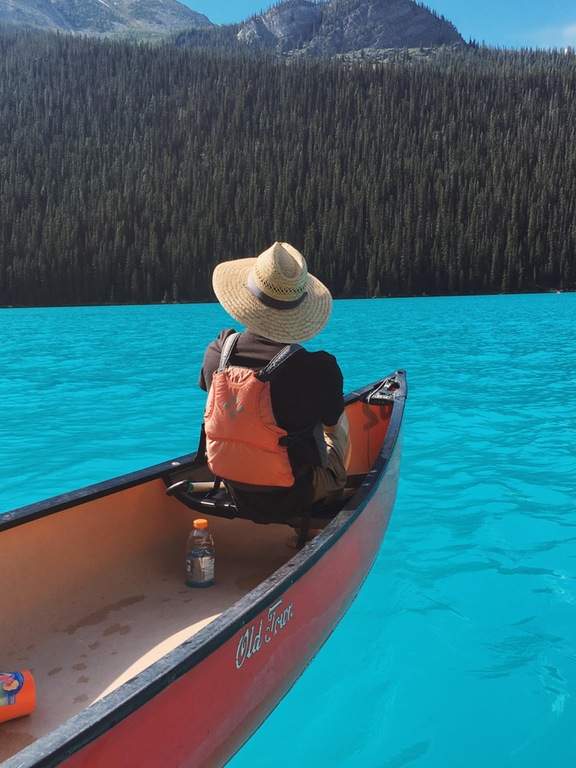 A picture I took on my iphone of my friend canoeing in lake louise, Banff national park.