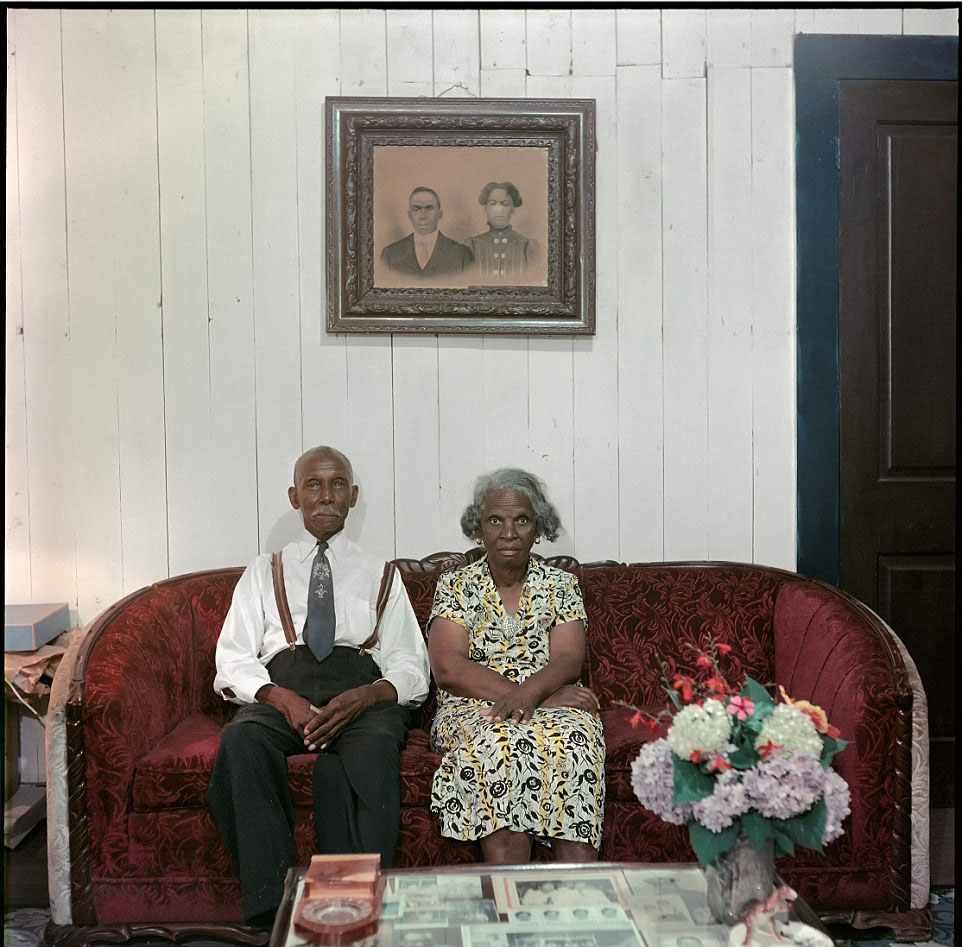 An elderly couple poses for a photo in their Alabama home, 1956.