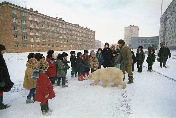 Elementary school students taking a biology class outside