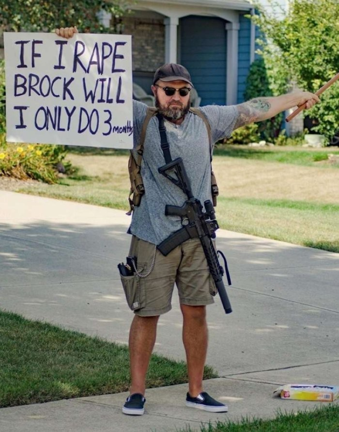 Protester outside Brock's house