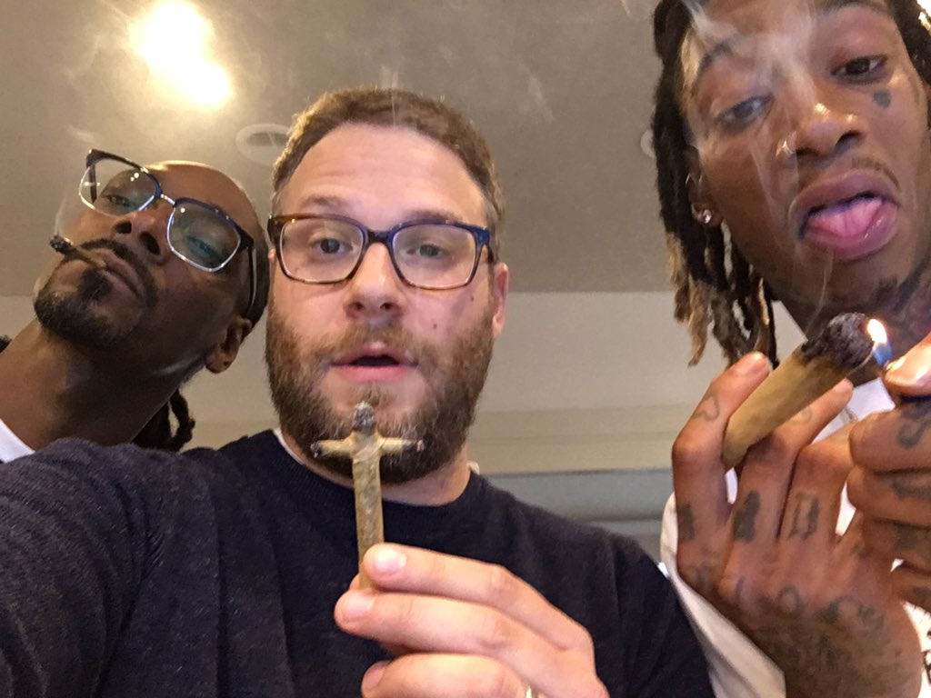 Seth Rogen, Wiz Khalifa and Snoop Dogg smoking together