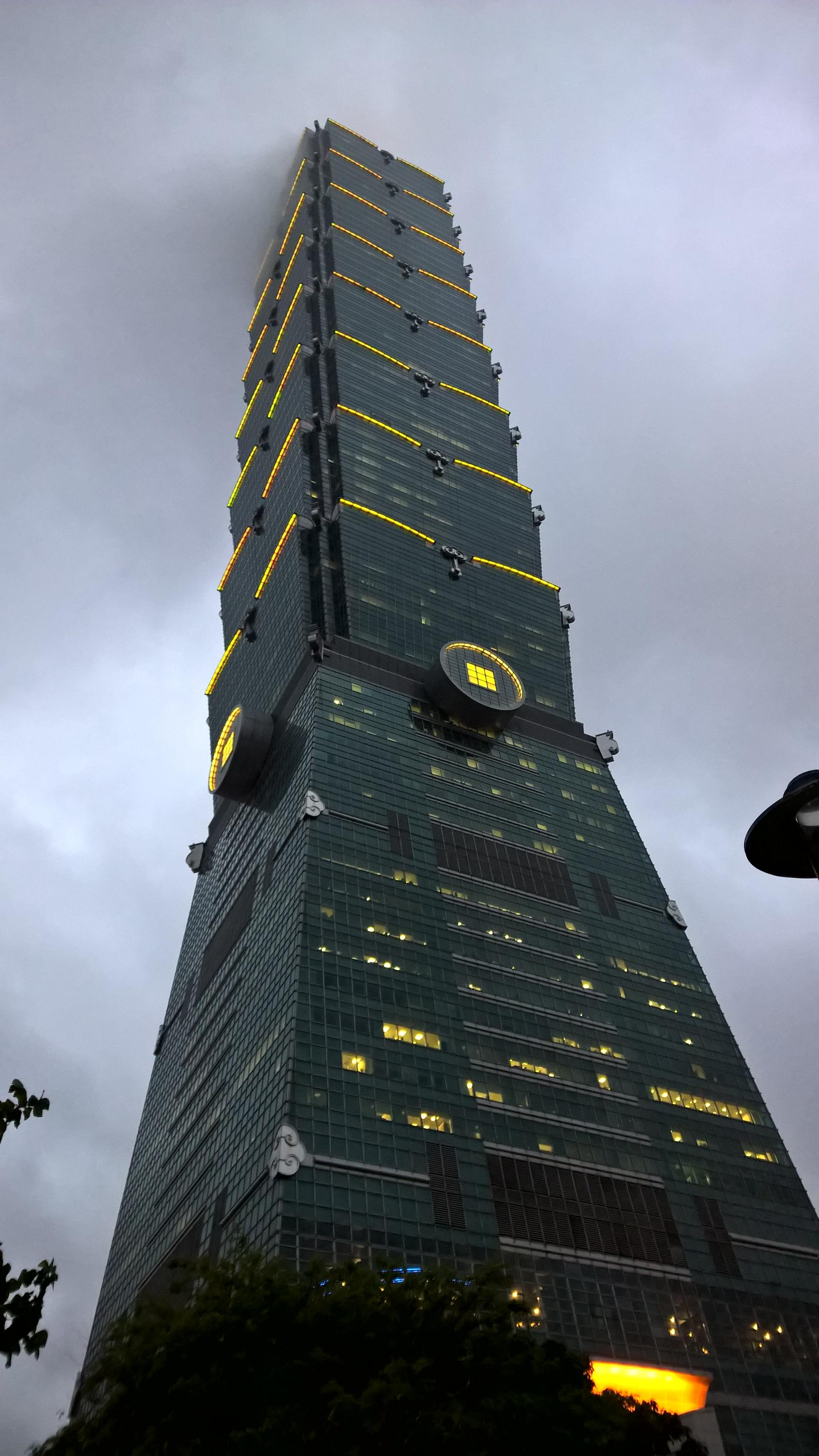 Taipei 101 in Taiwan disappearing into the clouds.