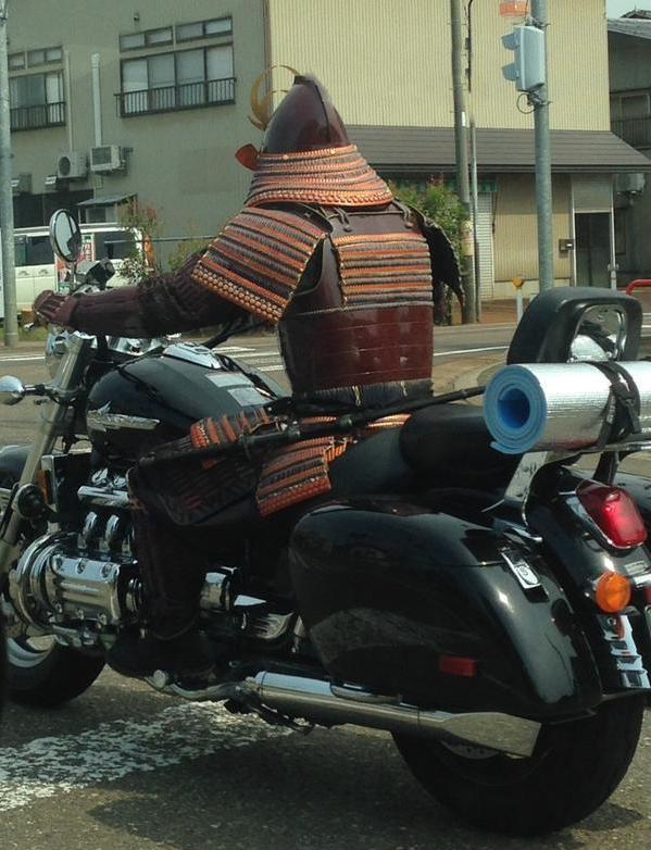 A Samurai with his trusty motorcycle steedA Samurai with his trusty motorcycle steed