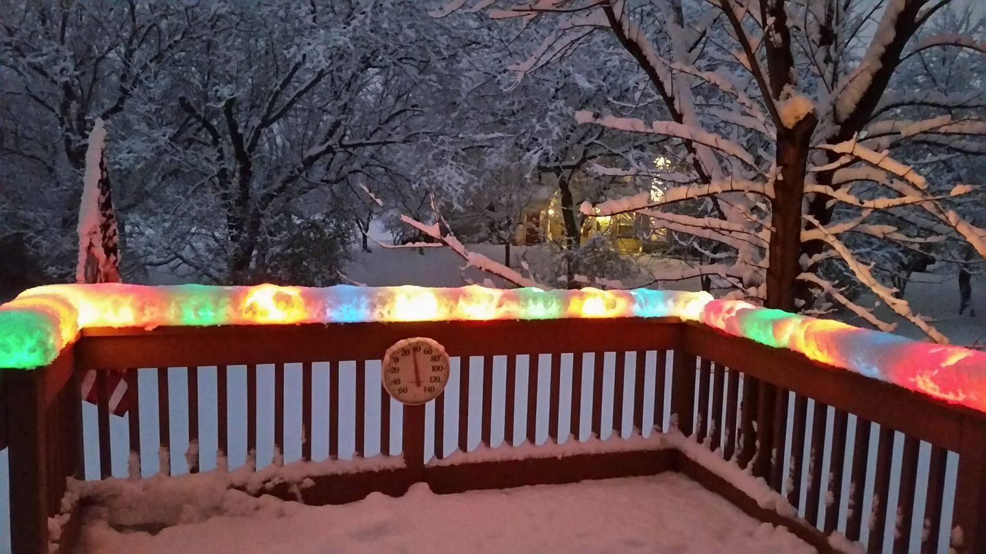 Christmas lights after a snowstorm
