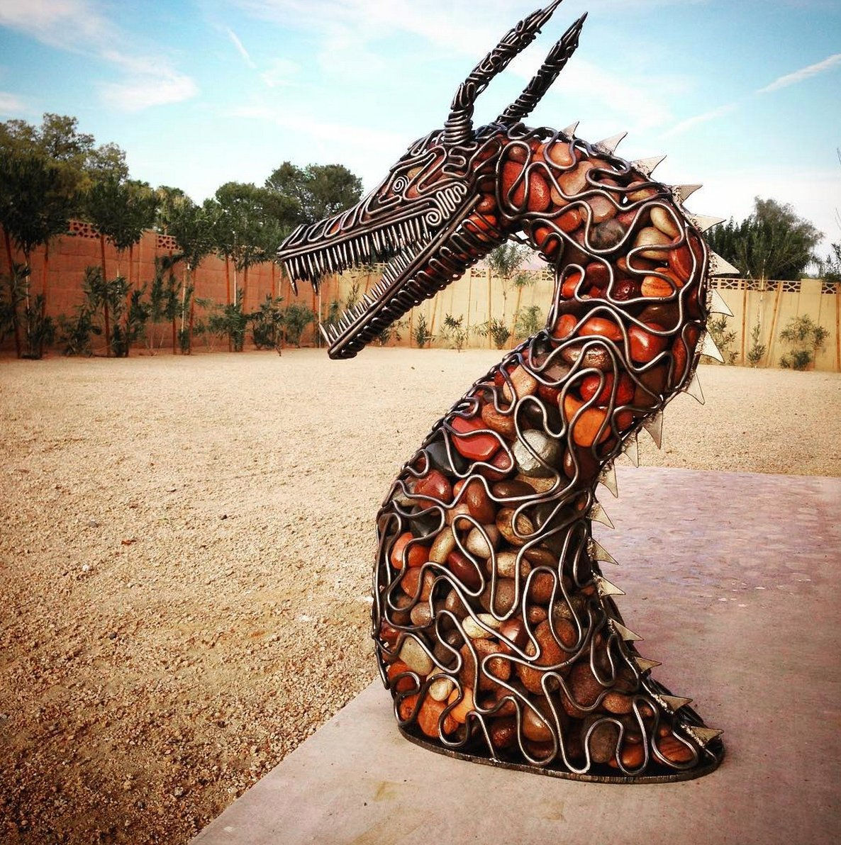 Dragon made from river rock and steel rods