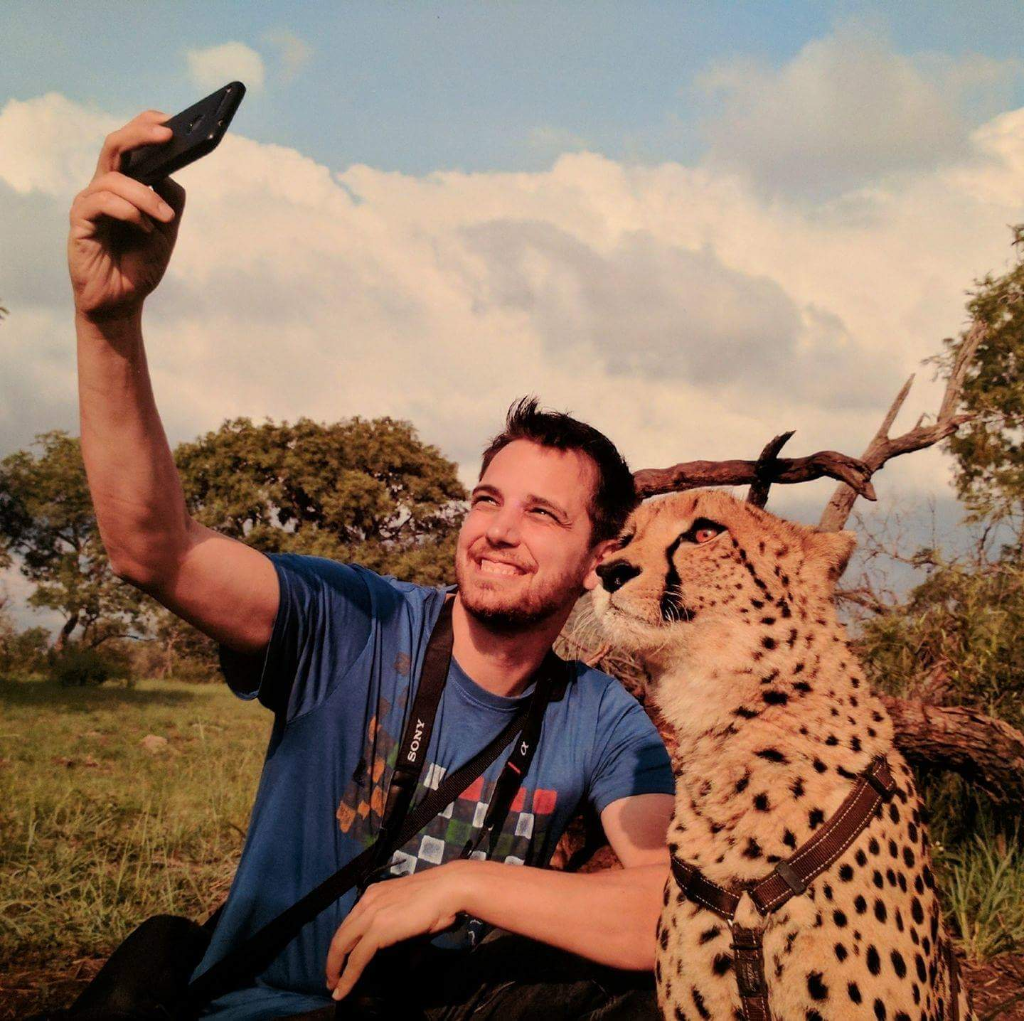 My buddy taking a selfie with a cheetah.