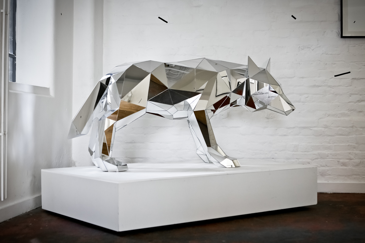 A wolf sculpture made of mirrors