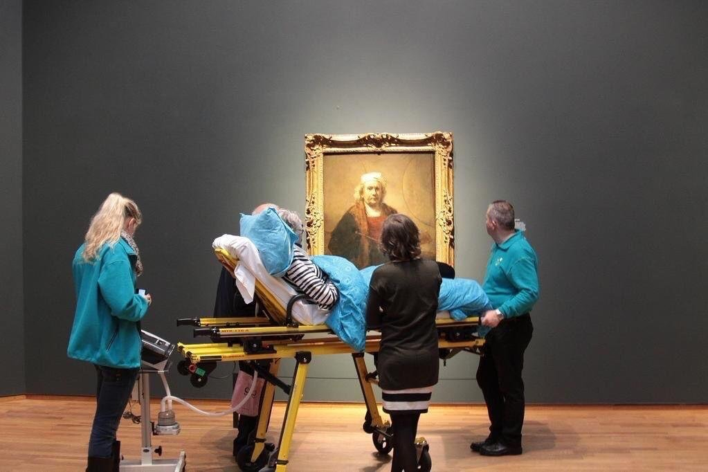 A woman enjoys the Rijksmuseum one last time