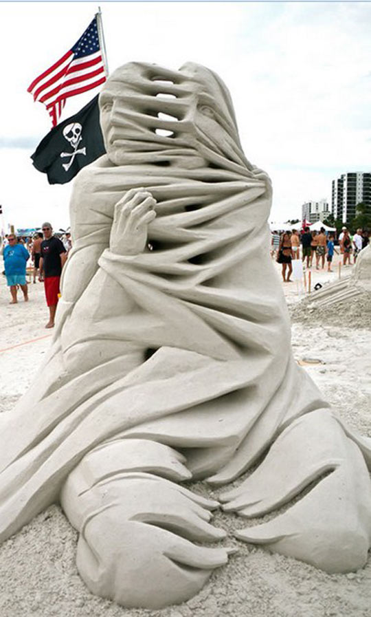 funny-sand-sculpture-person-divided