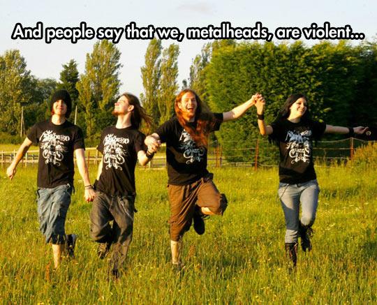funny-metalheads-jumping-happy-field